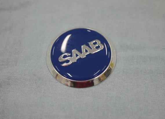 Saab 96:n ilmanvaihtoaukon merkki